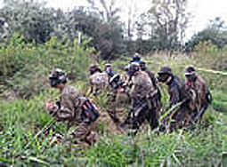 Group of paintballers moving through brush at chemawa paintball field