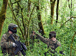 Two paintball Payers in the woods at chemawa paintball field