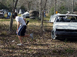 Player standing near car at battlegrounds Paintball