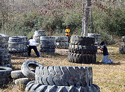 Hiding behind large tires at Battlegrounds Paintball Field