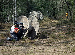Battlegrounds paintball Field player behind spool